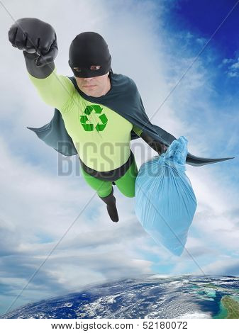 Green superhero flying away from Earth with bag of trash helping to keep the planet clean. Elements of this image furnished by NASA