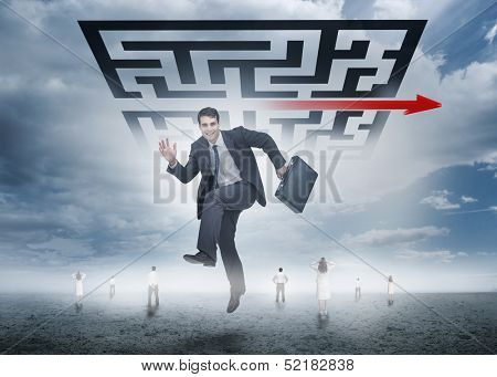 Businessman leaping happily in front of giant qr code with business people far below