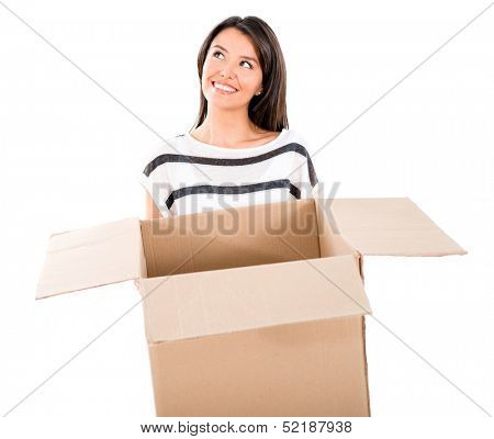 Thoughtful woman moving and holding a box - isolated over white