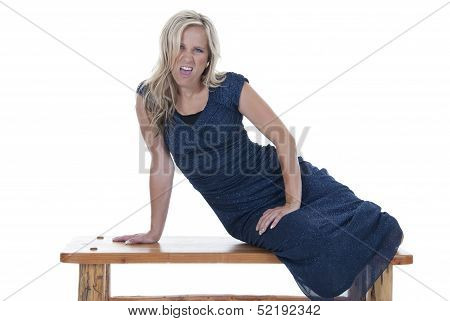 Attractive Blonde Model In Blue Dress On Bench With An Attitude