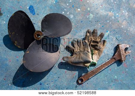 boat propeller improvement tools and gloves during a repair work