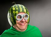 stock photo of maliciousness  - Funny man with watermelon helmet and googles looks like a parasitic caterpillar - JPG
