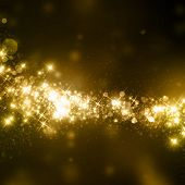 stock photo of cosmic  - Gold glittering stars dust trail background - JPG