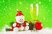 stock photo of glass-wool  - Christmas balls glass of wine and wool snowman as New Years Eve decor - JPG