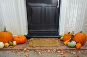 stock photo of front-entry  - Pumpkins on front steps of home during  Halloween - JPG