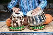 image of indian blue  - Man playing on traditional Indian tabla drums close up - JPG