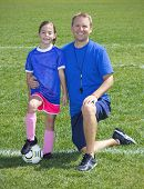 stock photo of little-league  - Soccer Coach and Soccer Player portrait - JPG