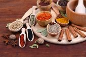 picture of cardamom  - Various spices and herbs on wooden table - JPG
