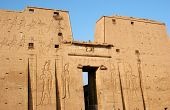stock photo of horus  - First pylon and entrance of the temple of Edfu an Egyptian temple dedicated to the chief god of Horus of the Sun at Edfu Egypt - JPG