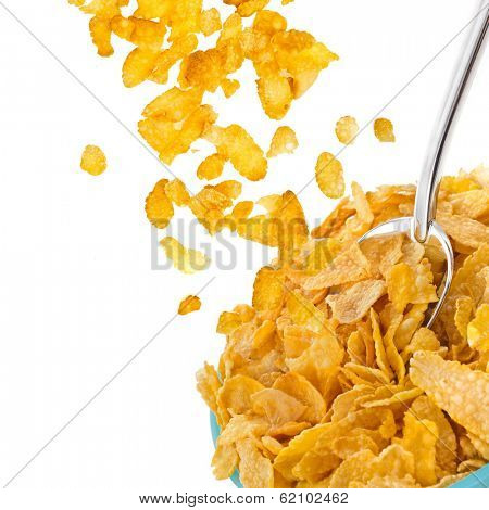 corn flakes falling in to bowl isolated on the white backgound