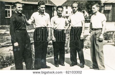 LODZ, POLAND, CIRCA 1960's: Vintage photo of group of men outdoor