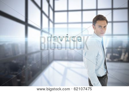 The word device and serious businessman with hand in pocket against room with large window showing city