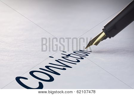 Fountain pen writing the word conviction