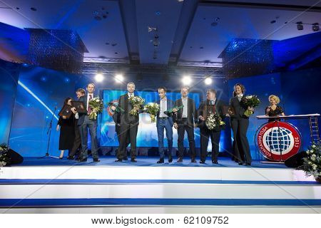 RUSSIA, MOSCOW - DEC 11, 2013: People with flowers on stage during presentation title Company of the Year 2013 in Lotte Plaza Hotel. Organizer - Rosbusinessconsulting.