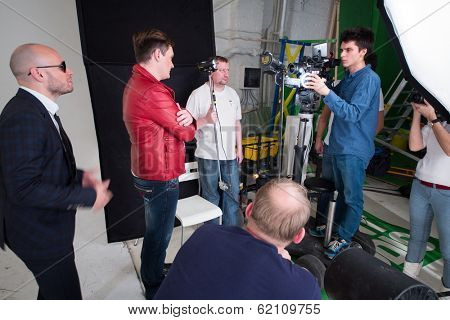 RUSSIA, MOSCOW - DEC 22, 2013: People working during shooting video clip of the musical group Hello with many feathers in Double Mint Studio.