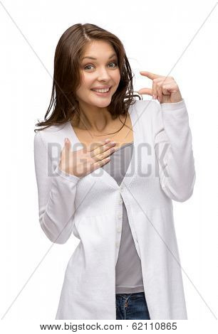 Half-length portrait of woman showing small amount of something, isolated on white