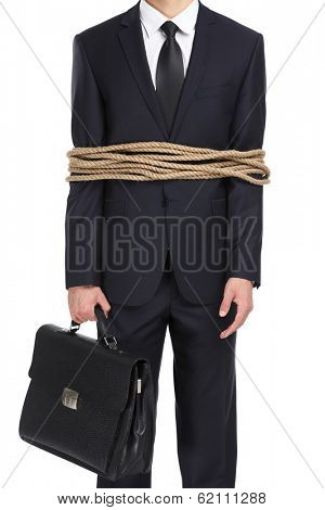 Portrait of businessman tied with the rope, isolated on white. Concept of slavery and violence