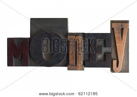 Word money in vintage wooden letterpress type, scratched and stained, isolated on white background