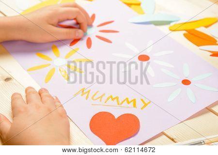 Unrecognizable Child Makes Card