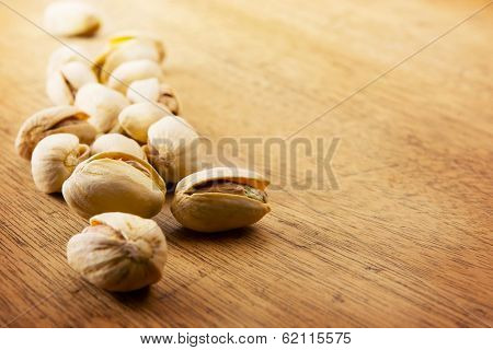 Pistachio nuts on a old kitchen desk.