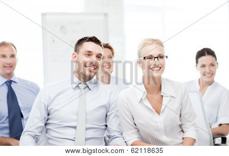 business concept - picture of smiling businessmen and businesswomen on conference