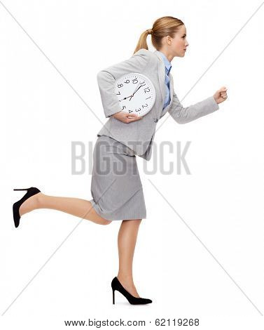 business, time and education concept - calm young businesswoman with clock running