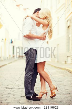 summer holidays and dating concept - couple in the city