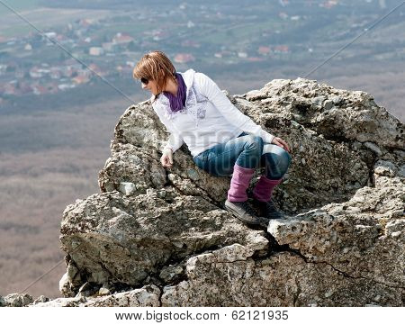 Young Woman On Cliff Edge