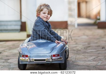 Little Boy Driving Big Toy Car, Outdoors