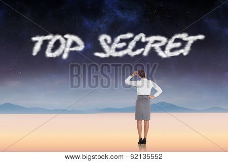 The word top secret and businesswoman scratching her head against serene landscape