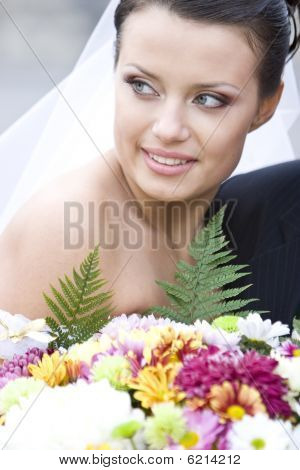 Charming Bride Holding Flowers