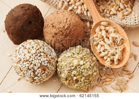 Macrobiotic Healthy Food: Balls From Ground Wheat Sprouts With Sesame, Pumpkin Seeds, Cocoa And Choc