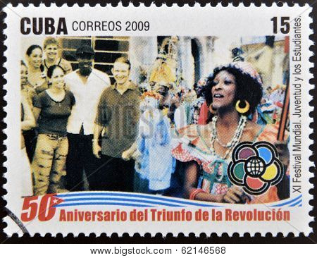 stamp dedicated to 50 anniversary of the triumph of the revolution shows global festival youth