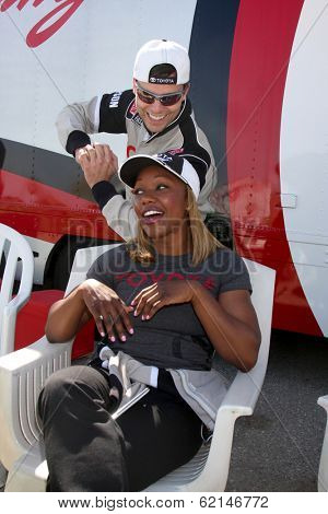LOS ANGELES - MAR 15:  Colin Egglesfield, Carmelita Jeter at the Toyota Grand Prix of Long Beach Pro-Celebrity Race Training at Willow Springs International Speedway on March 15, 2014 in Rosamond, CA