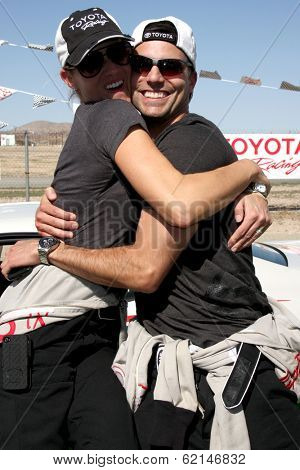 LOS ANGELES - MAR 15:  Tricia Helfer, Colin Egglesfield at the Toyota Grand Prix of Long Beach Pro-Celebrity Race Training at Willow Springs International Speedway on March 15, 2014 in Rosamond, CA