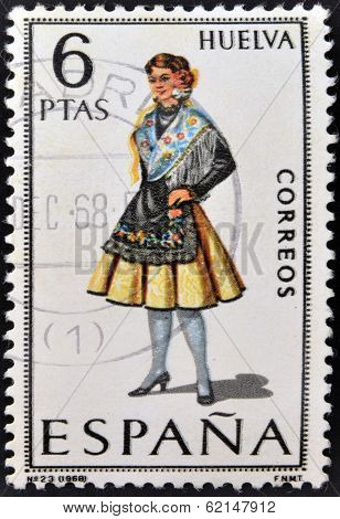 A stamp printed in Spain dedicated to Provincial Costumes shows a woman from Huelva