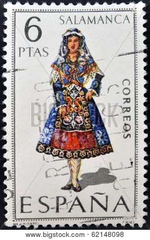A stamp printed in Spain dedicated to Provincial Costumes shows a woman from Salamanca