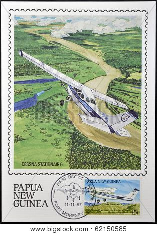 stamp shows A Cessna Stationair in flight over of Momase Region