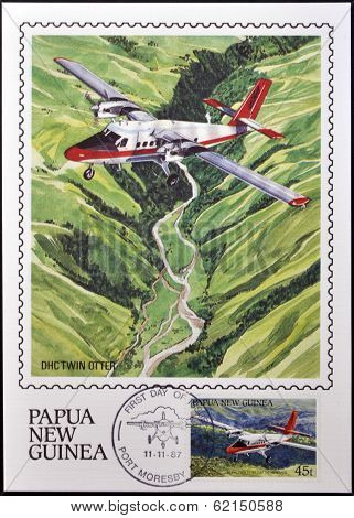A stamp printed in Papua shows A DHC Twin Otter in flight over of highlands of Papua New Guinea