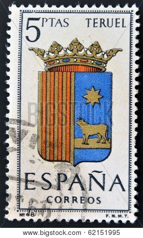 A stamp printed in Spain dedicated to Arms of Provincial Capitals shows Teruel