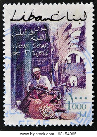 stamp printed in Lebanon shows View of street in Tripoli with traditional craftsman
