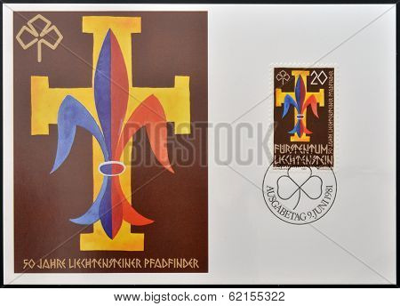 stamp dedicated to boy scouts and girl guides shows scout emblems: fleur-de-lis and trefoil