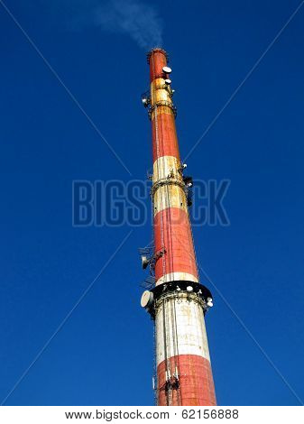A Tall Chimney With Smoke Visible