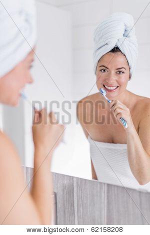 Mature woman brushing her teeth