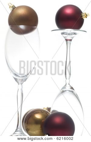 Christmas ornament on two champagne glasses