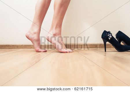 Bare feet female low section view