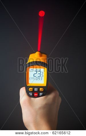 infrared laser thermometer in hand