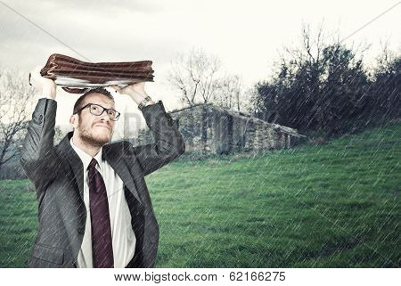businessman outdoor and heavy rain