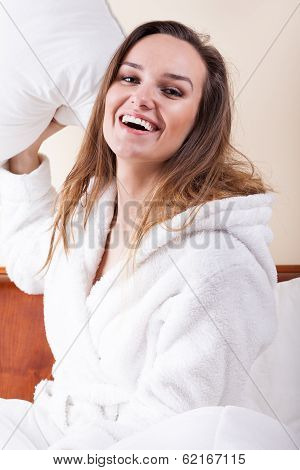 Happy Woman And Pillow Figh