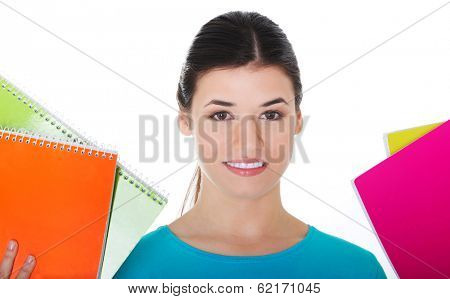 Portrait of a young beautiful female student holding workbooks. Isolated on white.